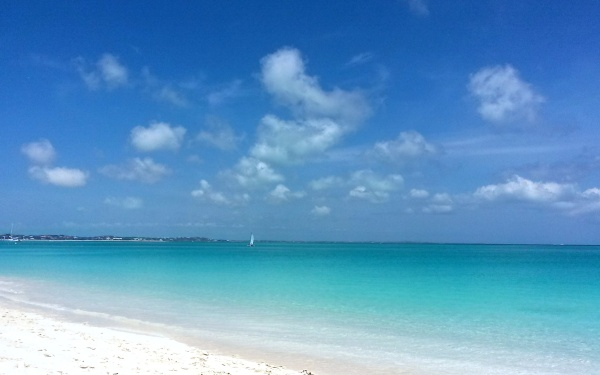 Don't forget to bring a book to read when you hit the beach. (Photo by Cindy Fazzi. Grace Bay beach, Providenciales, Turks and Caicos, June 2015.)