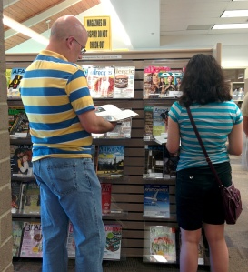 Ovum predicts that in 2020, consumers will still prefer print, just like these readers who are browsing magazines in a public library.